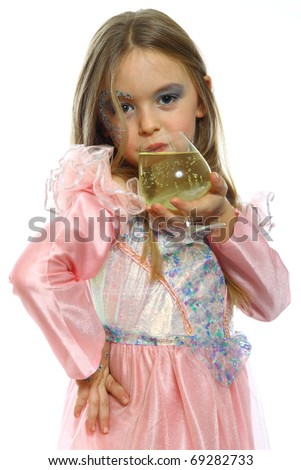 Cute little girl drinking juice isolated on white - stock photo