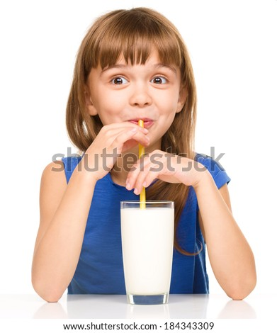 Cute little girl drinks milk using a drinking straw, isolated over white - stock photo