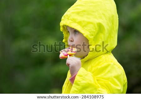 cute little girl eating a lollipop  - stock photo