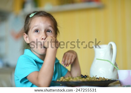 cute little girl eating  at home