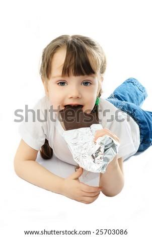 cute little girl eating chocolate - stock photo