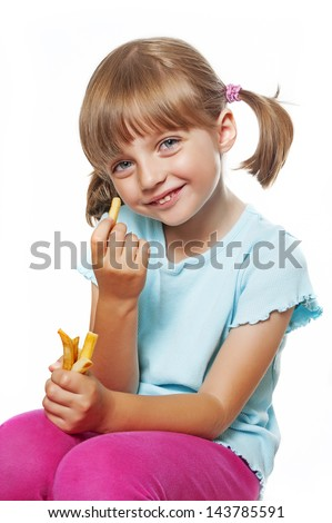 cute little girl eating french fries - stock photo