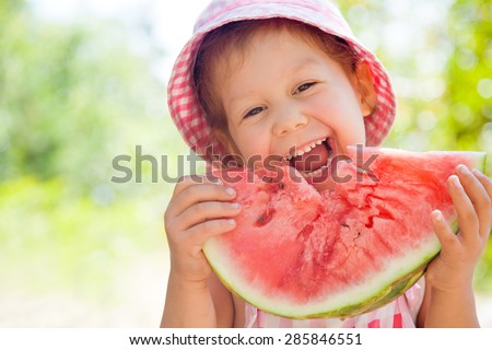 cute little girl eating watermelon in summertime - stock photo