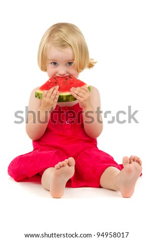 cute little girl eating watermelon on white background - stock photo