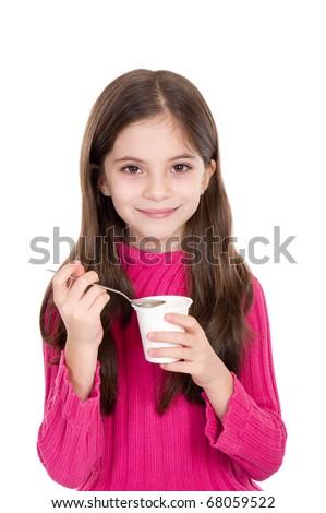 cute little girl eating yoghurt - stock photo