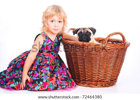 cute little girl embracing favorite dog in the basket  isolated on white - stock photo