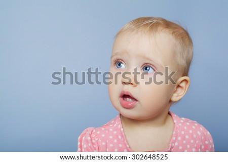 cute little girl emotional studio portrait on bright background - stock photo