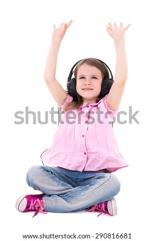 cute little girl enjoying music in headphones isolated on white background - stock photo