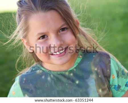 Cute little girl enjoying the outdoors - stock photo