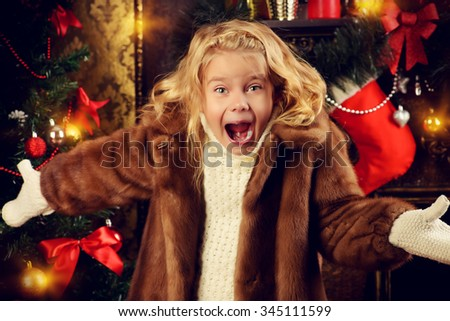 Cute little girl enjoys Christmas and New Year. Home decoration. The magic of Christmas. - stock photo
