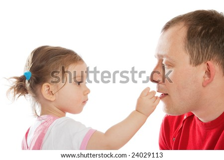 Cute little girl feeding her dad, isolated