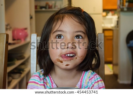 Cute baby girl eating chocolate for Small dirty room 7 letters
