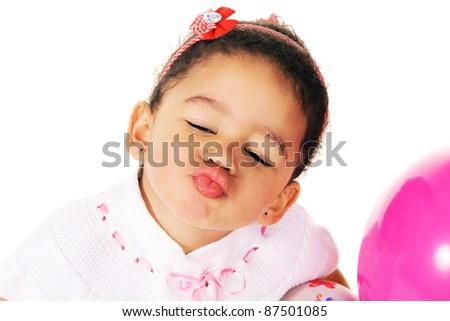 Cute little girl giving a kiss - stock photo