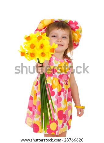 Cute little girl giving flowers. Studio shot