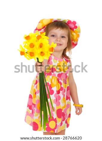 Cute little girl giving flowers. Studio shot - stock photo
