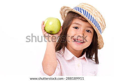 cute little girl, hand holding green apple - stock photo