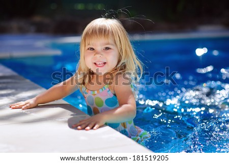 cute little girl has vacation and play in swimming pool - stock photo