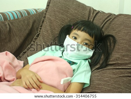 Cute little girl have a fever and wearing a protective mask, selective focus - stock photo