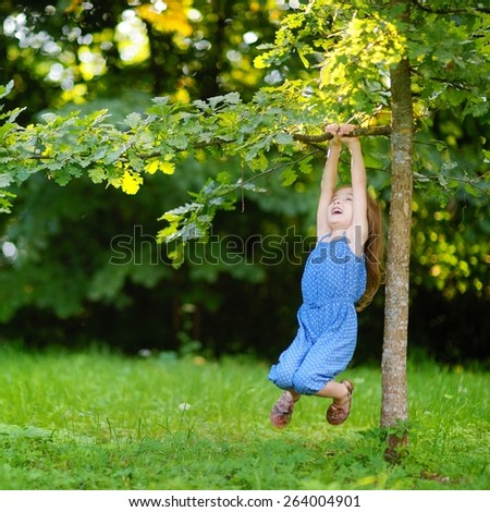 Cute little girl having fun in a park on a sunny summer day - stock photo