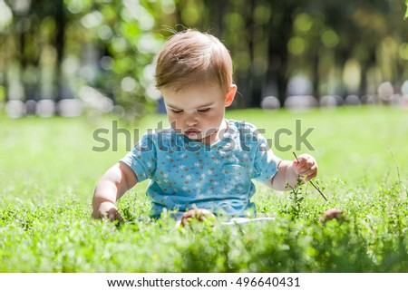 Cute little girl having fun outdoor on nature.