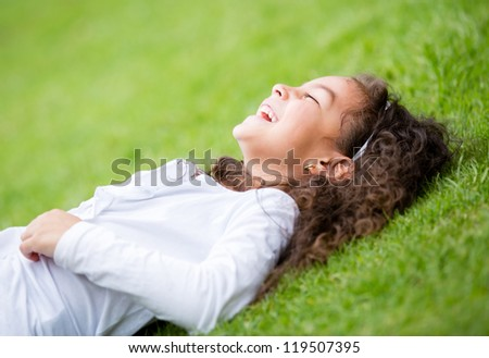 Cute little girl having fun outdoors and laughing - stock photo