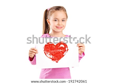 Cute little girl holding a painting of a red heart isolated on white background