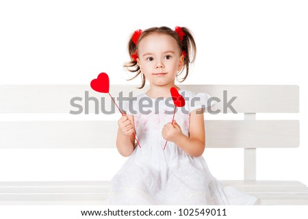 cute little girl holding a two heart