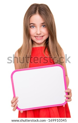 Cute little girl holding a white board - stock photo