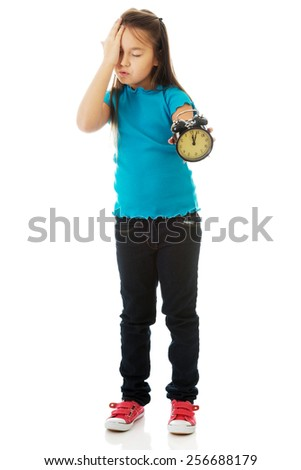 Cute little girl holding alarm clock - stock photo