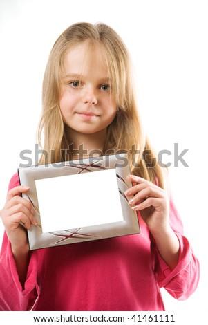 Cute little girl holding blank metal photo frame - stock photo