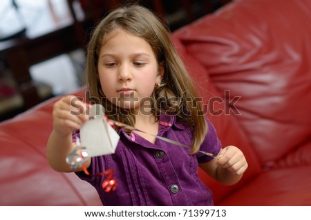 cute little girl holding gift box - stock photo