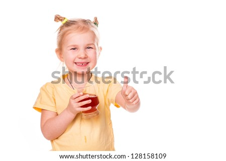Cute little girl holding glass with juice smiling with her thumb up isolated on white - stock photo