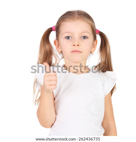 cute little girl holding her thumbs up - stock photo