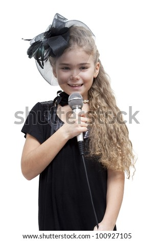 Cute little girl holding microphone. White background - stock photo