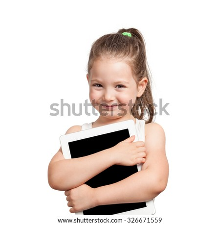 cute little girl holding tablet computer on white background - stock photo