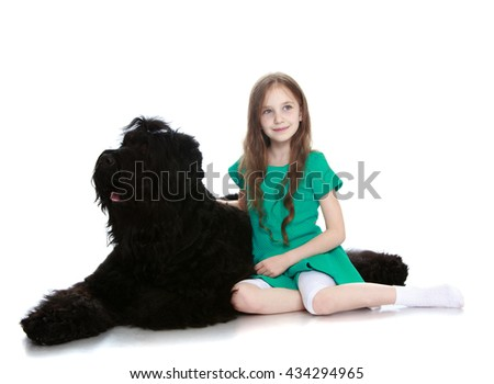 Cute little girl hugging a big black dog-Isolated on white background - stock photo