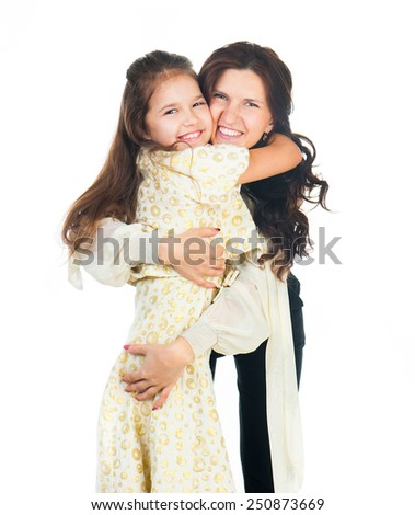 Cute little girl hugging her mother. Happy family. - stock photo