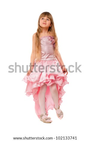 Cute little girl in a chic pink dress. Isolated