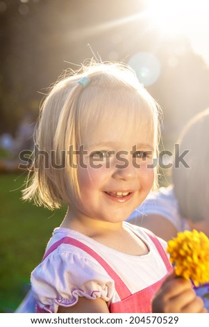 Cute little girl in a park - stock photo