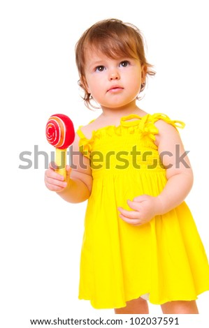 cute little girl in a yellow dress with toy. portrait of a close-up in the studio. isolated on white - stock photo