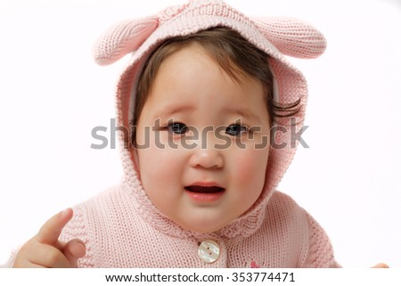 cute little girl in bunny costume with toys and gifts