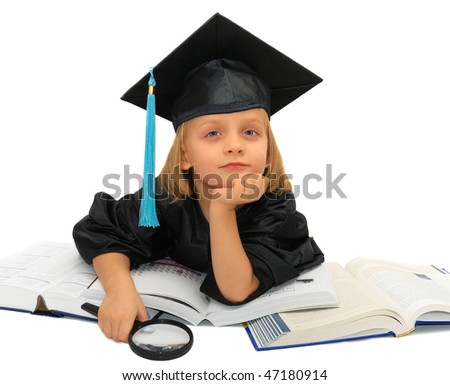 Cute little girl in graduation dress is raving about future - stock photo