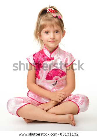 Cute little girl in pink ba ba shirt (Vietnamese), isolated over white - stock photo