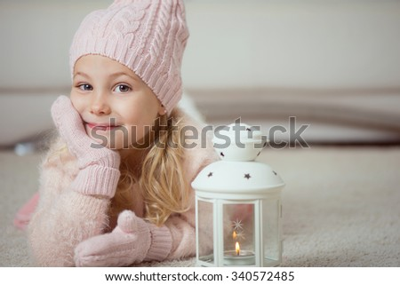 Cute little girl in pink celebrating Christmas