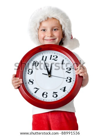 cute little girl in santa cap with a clock isolated oin white - stock photo