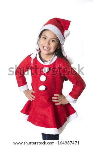 Cute Little Girl in Santa Claus costume standing happy at Christmas