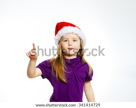 Cute little girl in santa hat touching transparent screen, isolated on white