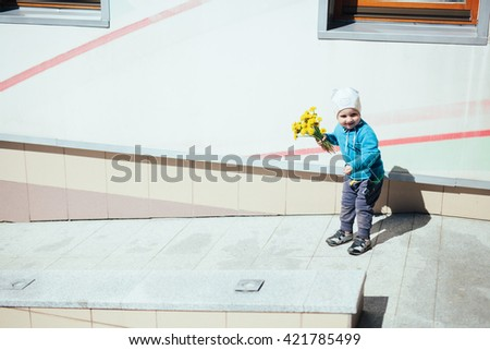 Cute little girl in spring day