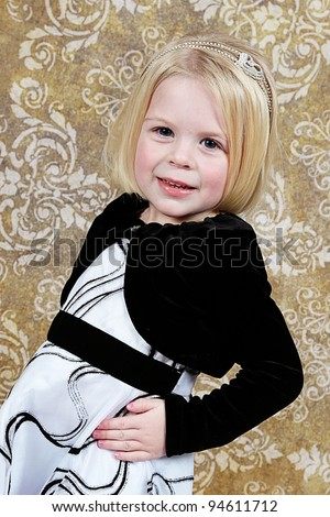 Cute little girl in studio posing for the camera