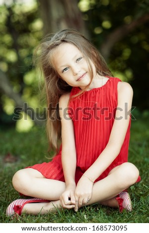 Cute little girl in summer day  - stock photo